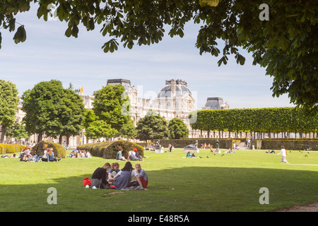 Jardin des Tuileries and the Louvre Museum, Paris. The museum is one of the largest in the World. - Stock Photo