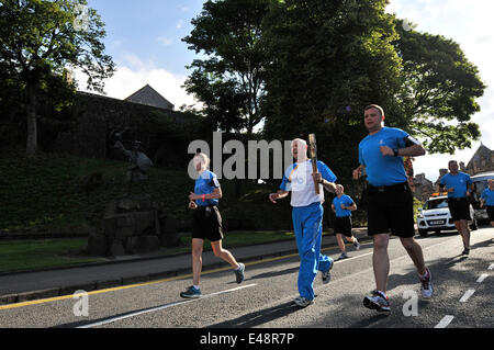 Stirling, Scotland, UK. 6th July, 2014. The Queens Baton Relay travels through Stirling. The baton is taken on a - Stock Photo