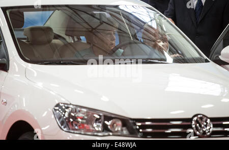 German Chancellor Angela Merkel sits in a Jetty VW car model during her visit to the FAW-VW Werk, Volkswagen's production - Stock Photo