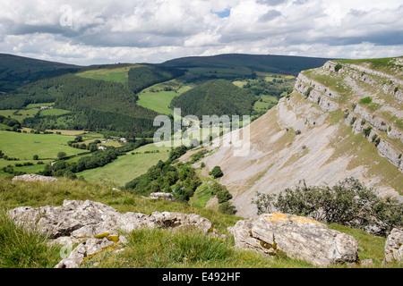Eglwyseg mountain limestone escarpment above green valley near Llangollen, Denbighshire, North Wales, UK, Britain - Stock Photo