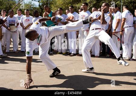 Sao Paulo, Brazil. 06th July, 2014. Brazilian street dancers perform Capoeira at the Ibirapuera Park in Sao Paulo, - Stock Photo