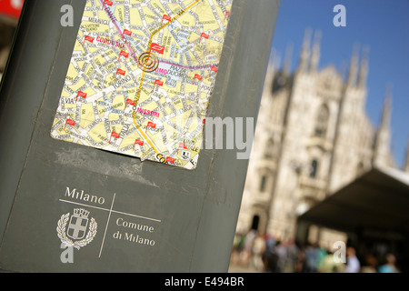 Map of cycle rental locations in central Milan, Italy, with the gothic Duomo or Cathedral behind. - Stock Photo