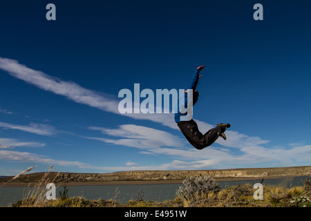 Happy man jumping, the Argentinian pampa - Stock Photo