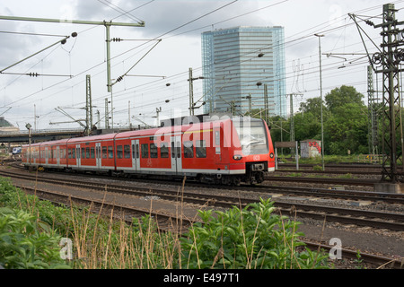 A S Bahn train leaves Mannheim station. It is operated by Deutsche Bahn - Stock Photo