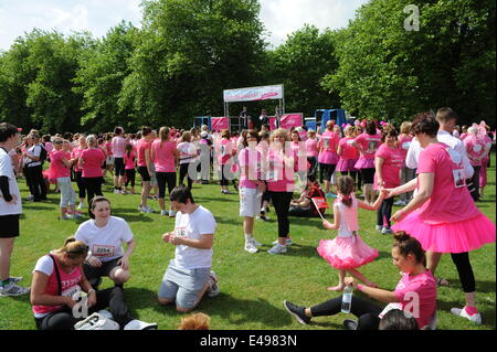 Liverpool, UK. Sunday 6th July 2014. Warm up begins. Cancer Research UK's Race for Life is a series of 5k or 10k - Stock Photo