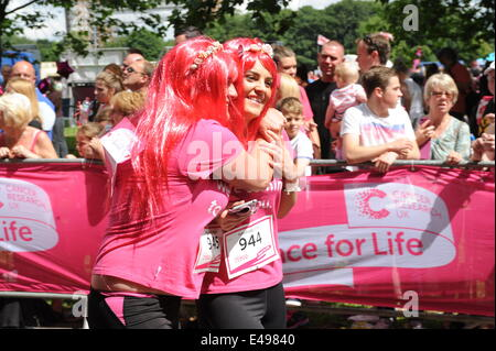 Liverpool, UK. Sunday 6th July 2014. Cancer Research UK's Race for Life is a series of 5k or 10k women-only fundraising - Stock Photo