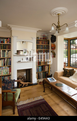 house interiors, small snug with bookshelves, of self-built house designed on arts and crafts design principles - Stock Photo