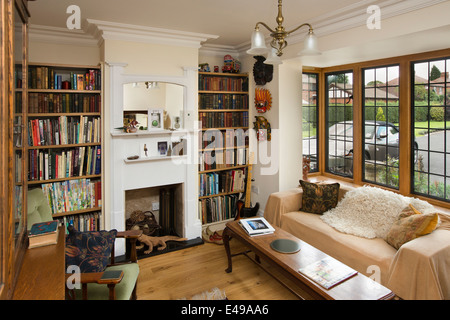 house interiors, small snug, with bookshelves of self-built house designed on arts and crafts design principles - Stock Photo
