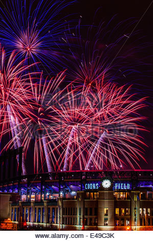 Fourth of July fireworks being fired from Coors Field (after a Colorado Rockies baseball game), Denver, Colorado - Stock Photo