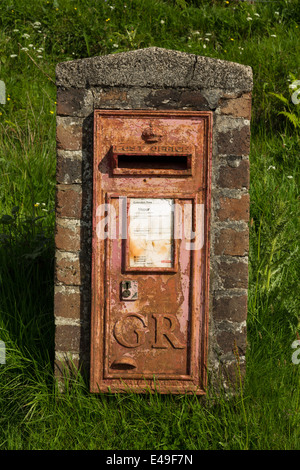Old rusty GR post box at Cleadale on the Isle of Eigg in Scotland. - Stock Photo