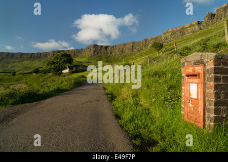 Lageorna and an old red GR Postbox at Cleadale, the isle of Eigg, Inner Hebrides, Scotland - Stock Photo