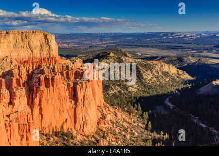 Rim cliffs and hoodoos lit by late afternoon sun with distant view in winter, Paria View, Bryce Canyon National - Stock Photo
