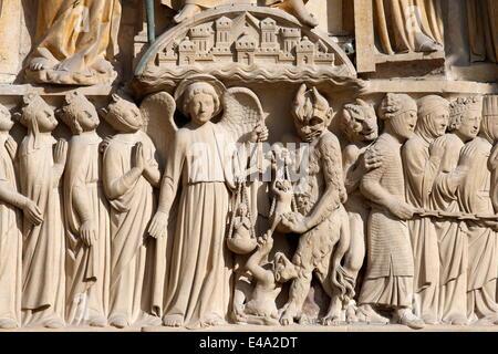 St. Michael weighing the souls, Portal of the Last Judgement, Western facade, Notre Dame de Paris Cathedral, Paris, France Stock Photo