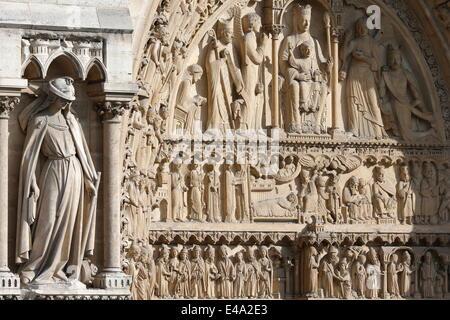 Statue of the Synagogue, St. Anne portal, Western facade, Notre Dame de Paris Cathedral, Paris, France, Europe - Stock Photo
