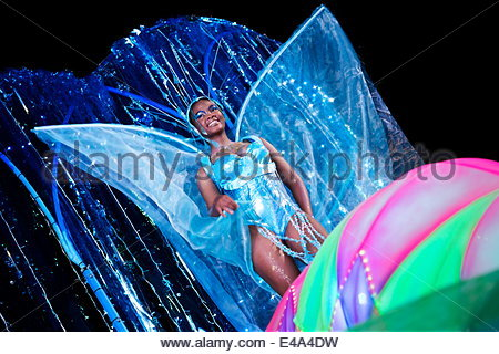 Woman wearing a blue butterfly costume at Cape Carnival, Fanfare street in GreenPoint, Cape Town, South Africa, - Stock Photo