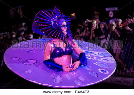 Female dancer in purple costume at Cape Carnival, Fanfare Street in GreenPoint, Cape Town, South Africa, Africa - Stock Photo