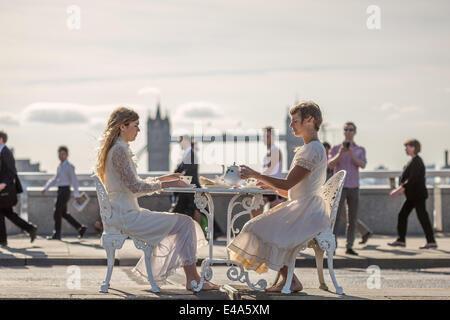 London, UK. 7th July, 2014. Two ladies take morning tea on London Bridge in UK. - Stock Photo