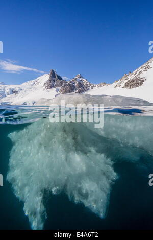 Above and below view of glacial ice in Orne Harbor, Antarctica, Polar Regions - Stock Photo