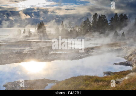 Freezing mists and thermal features, dawn, West Thumb Geyser Basin, Yellowstone National Park, UNESCO, Wyoming, - Stock Photo