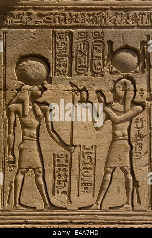 Dendera necropolis, Qena, Nile Valley, Egypt; carvings on the outside wall of the Temple of Hathor - Stock Photo
