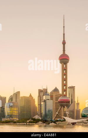 Pudong skyline of the Financial District including the Oriental Pearl Tower, across Huangpu River, Shanghai, China, - Stock Photo