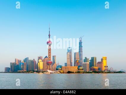 China, Shanghai, Pudong Skyline across Huangpu River, Oriental Pearl Tower, Shanghai World Financial Center, Shanghai - Stock Photo