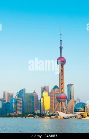 Skyline of Pudong Financial District including Oriental Pearl Tower, across Huangpu River, Shanghai, China, Asia - Stock Photo