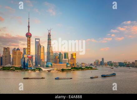Pudong skyline across Huangpu River, including Oriental Pearl Tower, Shanghai World Financial Center, Shanghai, - Stock Photo