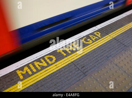 MIND THE GAP sign on platform edge, London Underground, London, England, United Kingdom, Europe - Stock Photo