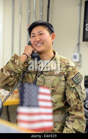 US Air Force Senior Airman Ashley Watson smiles during a phone conversation with Secretary of Defense Chuck Hagel - Stock Photo