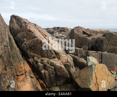 granite boulders around Perros-Guirec at the Pink Granite Coast in Brittany, France - Stock Photo
