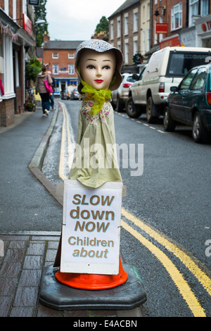 Traffic sign warning drivers to slow down for children in Much Wenlock, Shropshire, England - Stock Photo