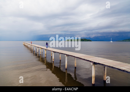 South East Asia, Kingdom of Brunei, girls on pier - Stock Photo