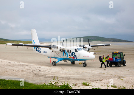 Flybe plane on sandy airstrip Isle of Barra airport , Outer Hebrides, Scotland - Stock Photo