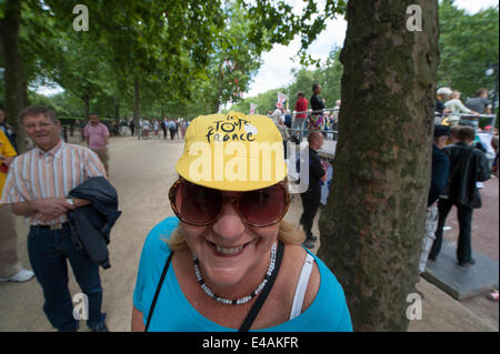 The Mall, London UK. 7th July 2014. Huge crowds await the arrival of the Tour de France runners on The Mall. Credit: - Stock Photo