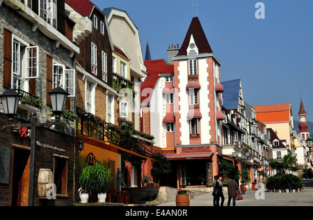 BAI LU, CHINA: View looking north on the main street of the Sino-French village with its French Alsatian-inspired - Stock Photo