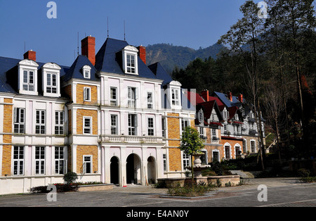 BAI LU / SICHUAN, CHINA: Normandie style faux chateau and half-timbered manor houses in the recreated Sino-French - Stock Photo