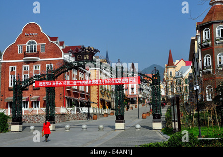 BAI LU, CHINA: Wrought iron gates lead into the principal street lined by Alsatian style buidings in the Sino-French - Stock Photo