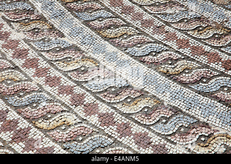 Corner decoration from the Roman mosaic of Theseus and the Minotaur at the Villa of Theseus, Paphos, Cyprus - Stock Photo