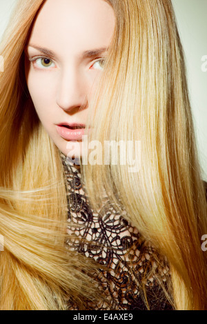 Beautiful woman with long, blonde hair - Stock Photo