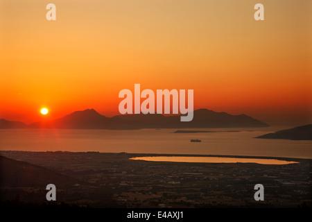 Sun setting behind Kalymnos island.  Photo taken from Dikaios mountain, Kos island, Dodecanese, Aegean sea, Greece