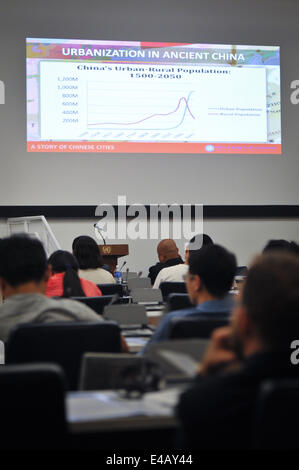 New York, USA. 7th July, 2014. Participants listen to a keynote address during a forum entitled 'A China Story: - Stock Photo