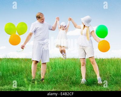 happy family outdoor on a summer day - Stock Photo