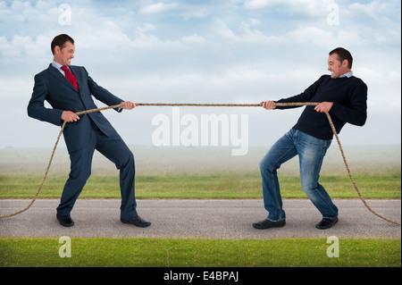 tug of war work life balance conflict concept - Stock Photo