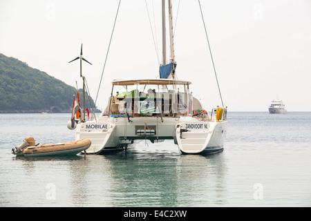 A catamaran off Sivota, Greece. - Stock Photo