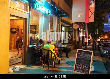 Asheville, North Carolina. People outside café at night. - Stock Photo