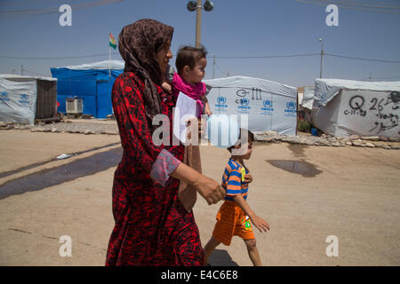 Kawergosk Camp, Iraq. 9th July, 2014. Caught between wars, Syrian refugees live day by day in the Kawergosk Refugee - Stock Photo