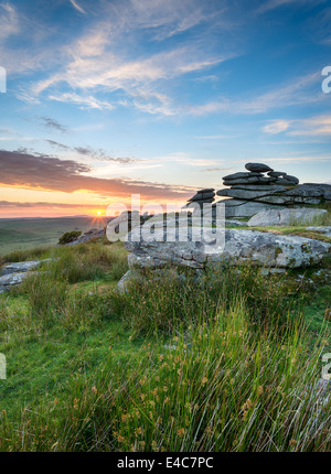 Sunset at the Cheeswring a granite tor on Bodmin Moor in Cornwall - Stock Photo