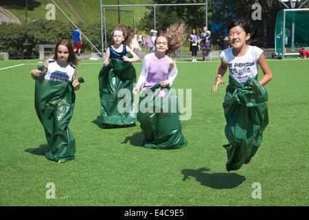 Kids potato sack racing - Stock Photo