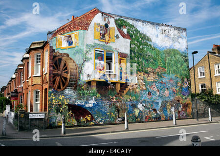 Early morning summer sun lights up the Big Splash mural on the end wall of a terraced house, Brixton, London. - Stock Photo
